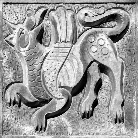 fairy winged agressive wolf  bas-relief on the wall
