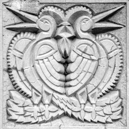 two fairy birds, stone bas-relief on the wall
