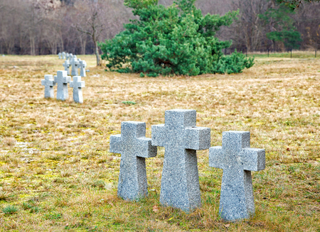 soreness: stone crosses in the old cemetery on gloomy cold autumn day Stock Photo
