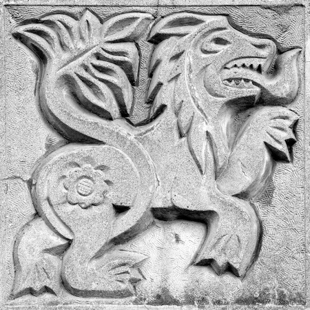 fairy agressive lion, stone bas-relief on the wall