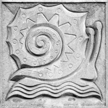 fabulous snail, a stone bas-relief on the wall