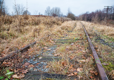 old abandoned railroad on gloomy cold autumn day