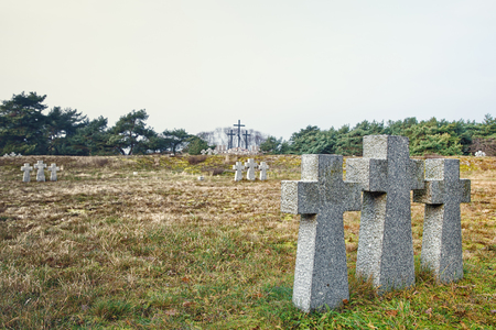 stone crosses in the old cemetery on gloomy cold autumn day Stock Photo