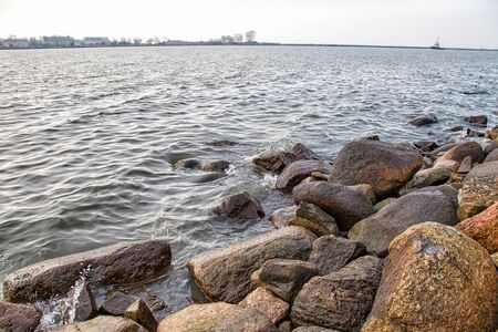 shore of the lake on cold gloomy late autumn day Stock Photo