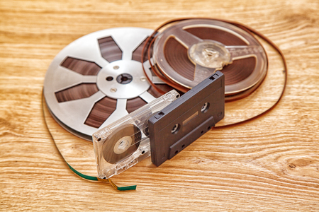 grabadora: cassettes tape and reel lying on the floor closeup