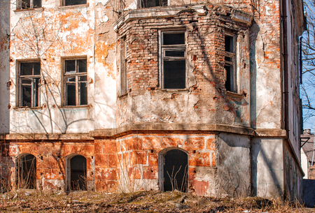 old abandoned house in the city on sunny spring day closeup Stock Photo