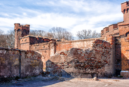 ruined wall of an old abandoned fortress on sunny spring day