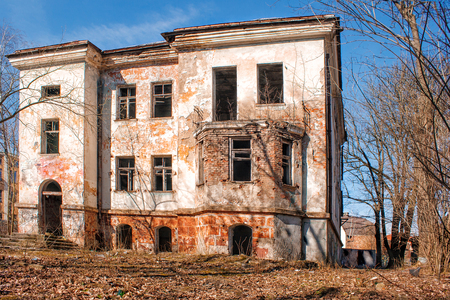 old abandoned house in the city on sunny spring day
