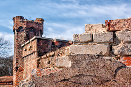 ruined wall of an old abandoned fortress on sunny spring day closeup