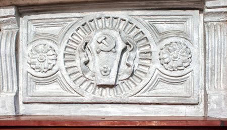 retro bas-relief with a hammer and sickle of the ussr outdoor closeup
