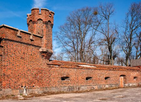 tower and brick wall of the old fortress on sunny spring day