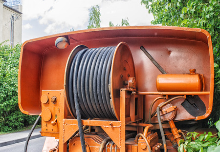 special steel: large yellow metal coil with electric cable on a special car outdoor