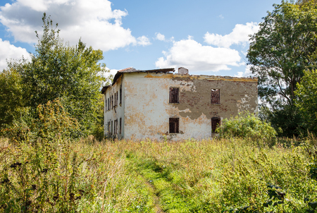 abandoned brick house from the outside on summer day Stock Photo