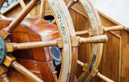 wooden ship retro steering wheel outdoor closeup