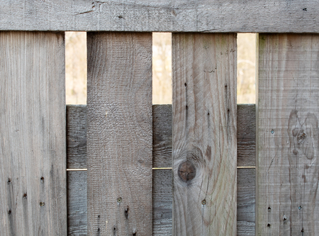 fence of rough brown boards outdoor on sunny day detail closeup