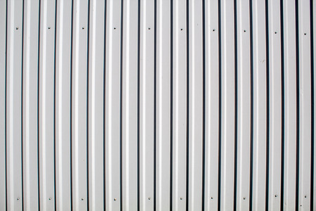 sheet white metal fence outdoor on sunny day closeup Stock Photo