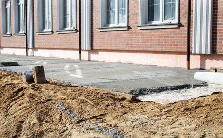 concrete pavement near the new building on sunny summer day