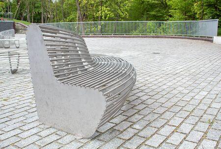 modern metal round garden bench in the city park on sunny summer day Reklamní fotografie