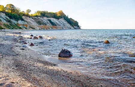 high cliff on the seashore on sunny autumn day