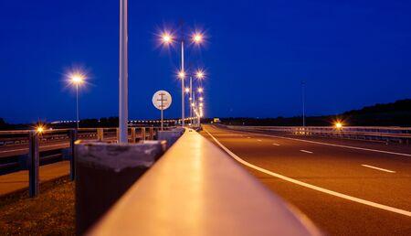 new modern illuminated highway at blue night