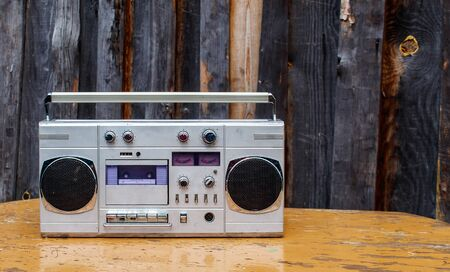 retro cassette player on wooden table outdoor closeup