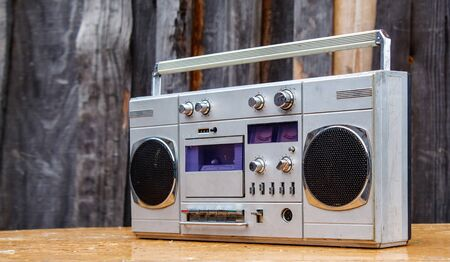 retro cassette player on wooden table outdoor closeup Stock Photo
