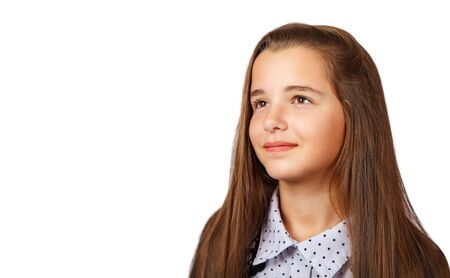 beautiful brunette teen girl with long hair looking upwards in interest. isolated on white background Banco de Imagens
