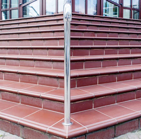 new modern brown stone staircase in front of the house on summer day Stock Photo