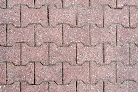 road paved with sidewalk tiles. beautiful brick background with, masonry texture of light brown bricks. outdoor closeup Stock Photo