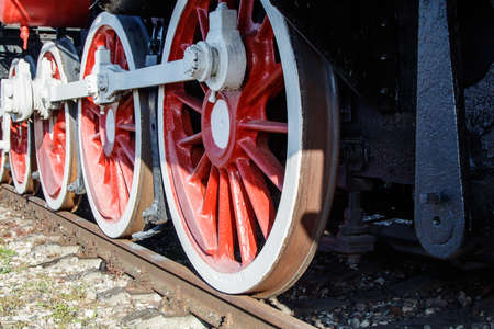 old vintage locomotive wheels closeup outdoor on sunny day