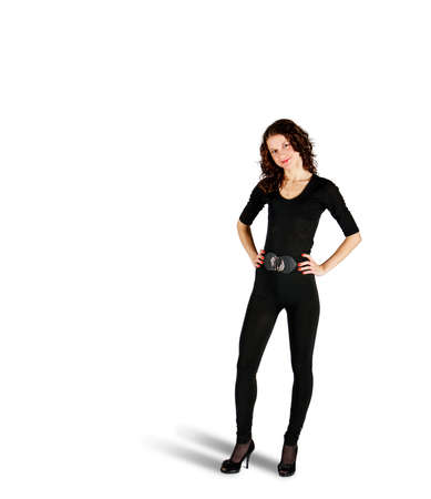 young beautiful woman in black suit posing standing in studio on white background Standard-Bild