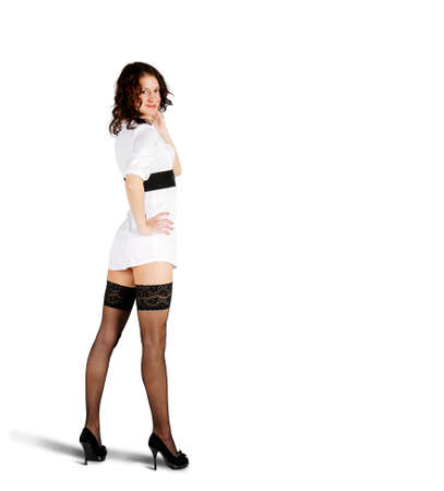 young beautiful woman in white short dress posing standing in studio on white background
