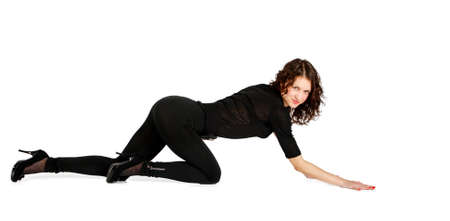 young beautiful woman in black suit posing standing on all fours in the studio on white background