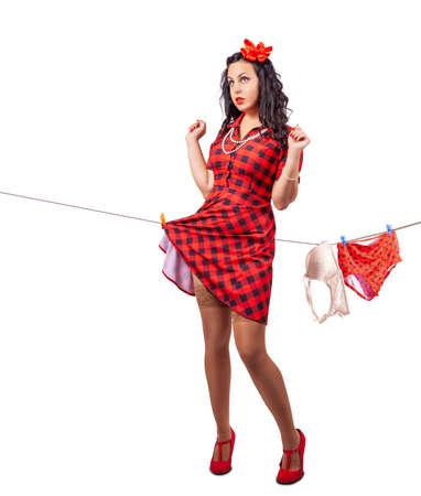young beautiful woman hanging underwear. studio shot. pinup style Standard-Bild