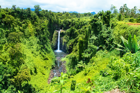 Pristine waterfalls in the middle of tropical jungle of Upolu Island, Sopoaga Falls in Samoa, Polynesia central Pacific Ocean Stock Photo