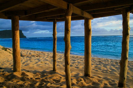 Deep blue waters of Pacific Ocean wiev through wooden pillars of beach fale - traditional Samoan house Lalomanu beach Samoa, Polynesia Stock Photo