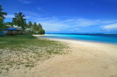 Manase beach in Savai'i the biggest island of Samoan Islands in Pacific Ocean with azure water, hot sand and tropical palm trees