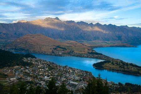Breathtaking Queenstown New Zealand resort city panorama with The Remarkables mountains range and Lake Wakatipu, the world's capital of adventures, South Island, Otago Stock Photo