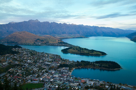 Afternoon view of Queenstown New Zealand resort town panorama with city houses, The Remarkables mountain range and Lake Wakatipu, Central Otago in South Island Stock Photo
