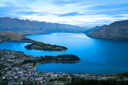 Scenic view of alpine resort town Queenstown New Zealand with famous landmarks The Remarkables mountains and Cecil peak, tourist holiday destination in Southern Alps, Otago Stock Photo - 111393869