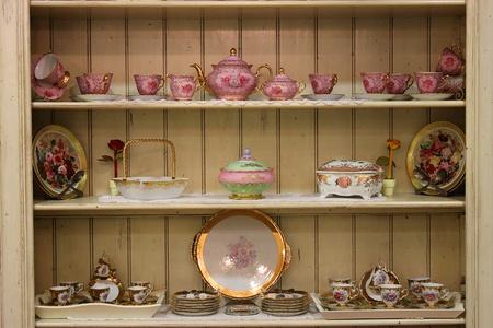 tea set on wooden cupboard old style fashion photo