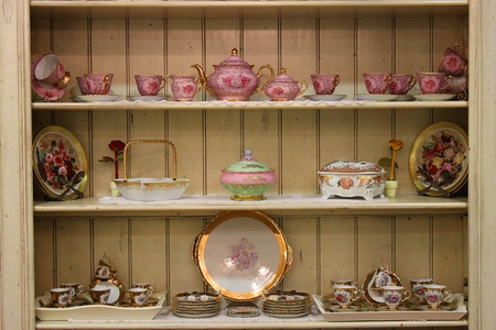 cupboard: tea set on wooden cupboard old style fashion Stock Photo