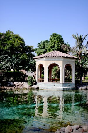 pavilion in the garden with palm trees Editorial