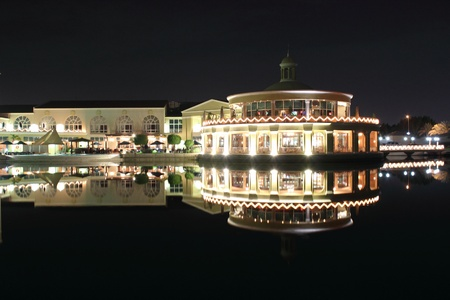 restaurant and bar near lake at night Editorial