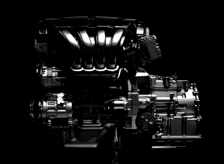 car transmission: new car engine isolated on black background