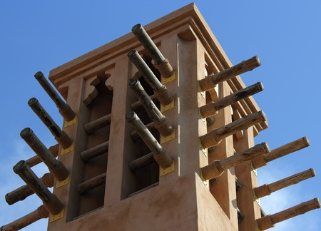 old wind towers in dubai with clear blue sky