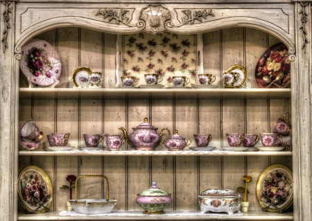 arranging: vintage tea cup set print for sale Shabby chic is a form of interior design where furniture and furnishings are either chosen for their appearance of age and signs of wear and tear or where new items are distressed to achieve the appearance of an antique  Stock Photo