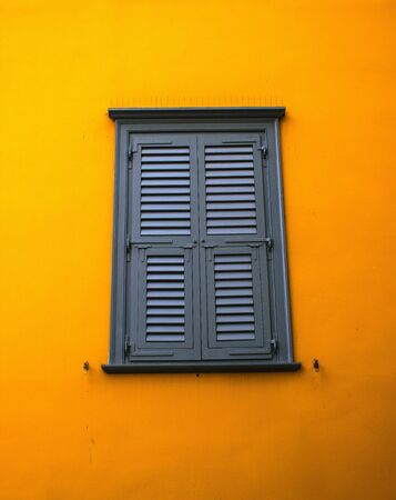window on yelow wall photo
