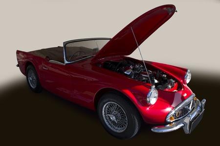 Dubai, UAE - March 09, 2013 : Red Daimler on display at the emirates classic car festival Dubai, UAE.