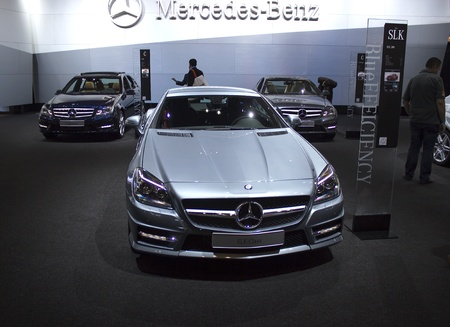 benz: Dubai, UAE - NOVEMBER-14-2011: Mercedes Benz SLK Class on display at the Dubai Motor Show, UAE.